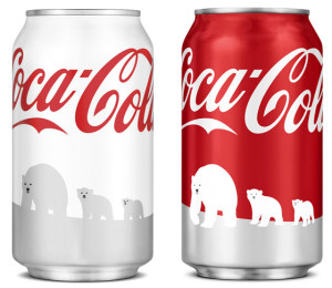 The original holiday Coca-Cola can design and the revised can design.
